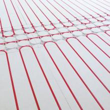 Dry screed high efficiency under-floor heating system