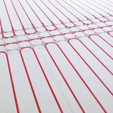 Dry screed high efficiency under-floor heating system
